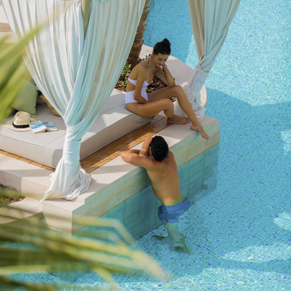 Couple relaxing in the Jumeirah Al Naseem Wadi Pool