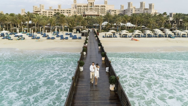 Pier Beach Couple at Jumeirah Al Qasr