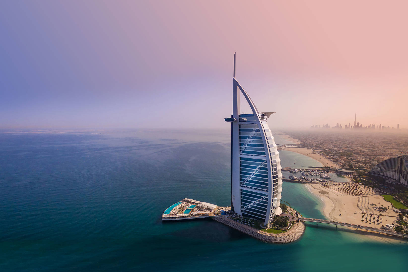 Airal exteria shot of Jumeirah Arab Burj Al Arab, including sea and beach