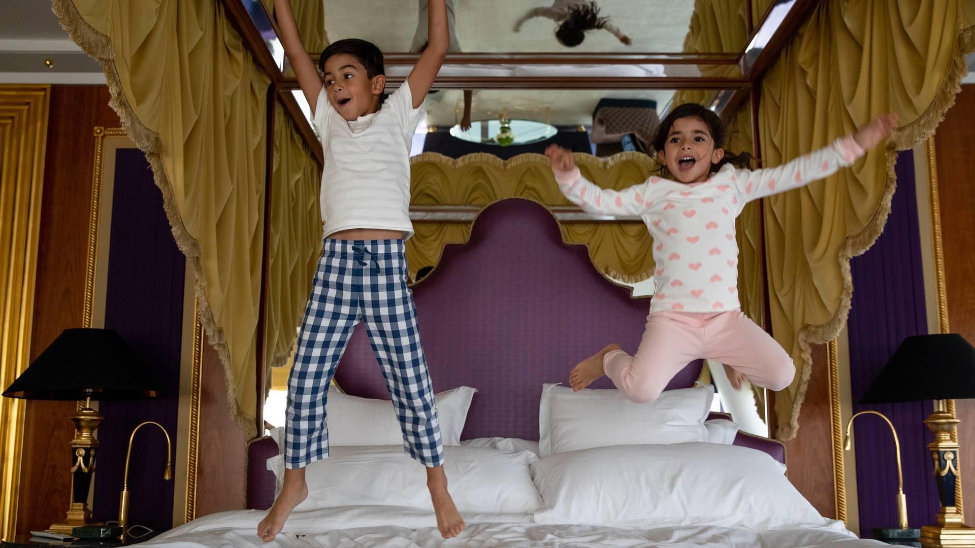 Jumeirah Burj Al Arab Three bedroom suite kids jumping on bed_16-9