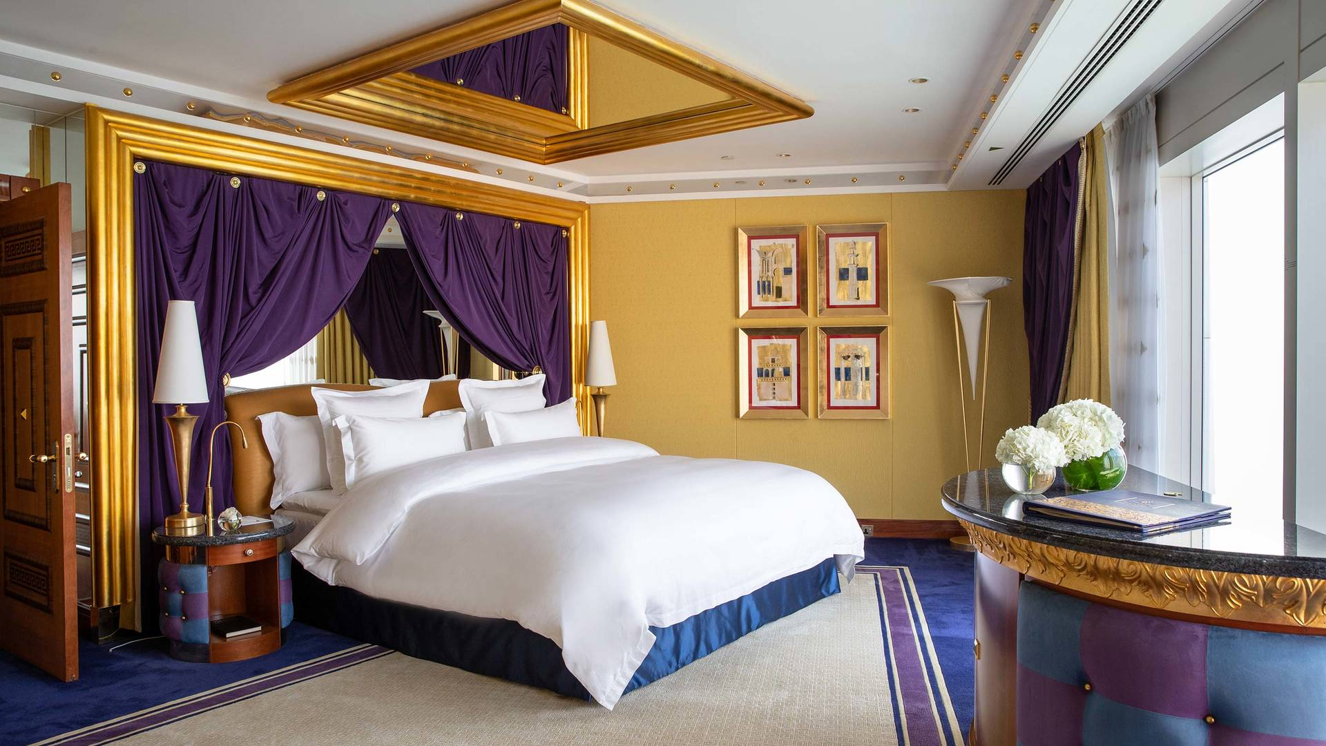 Jumeirah Burj Al Arab Bedroom Suite with bed and mirror