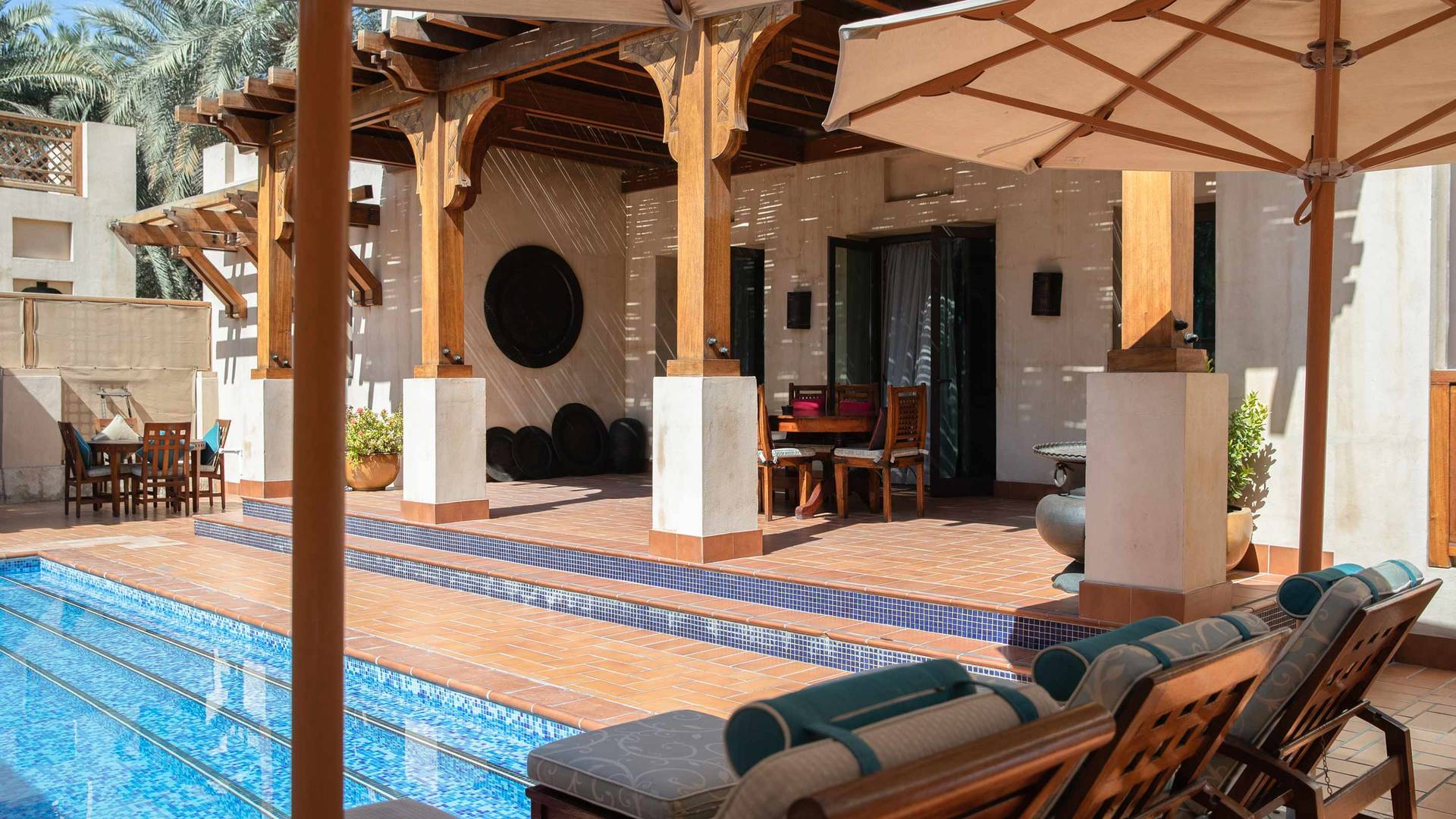 Jumeirah Dar Al Masayaf Three Bedroom Malakiya Villa pool and sun lounge area