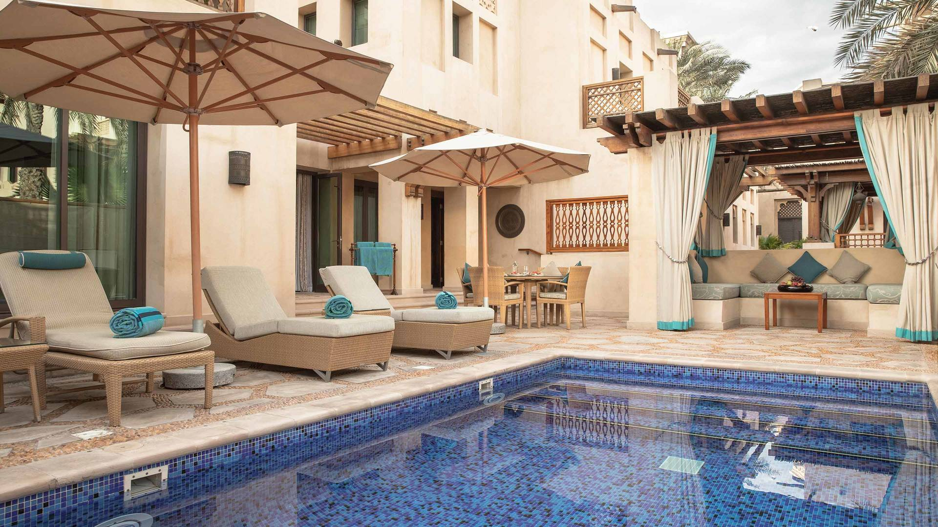 Jumeirah Dar Al Masayaf Two Bedroom Malakiya Villa pool and sun lounge area