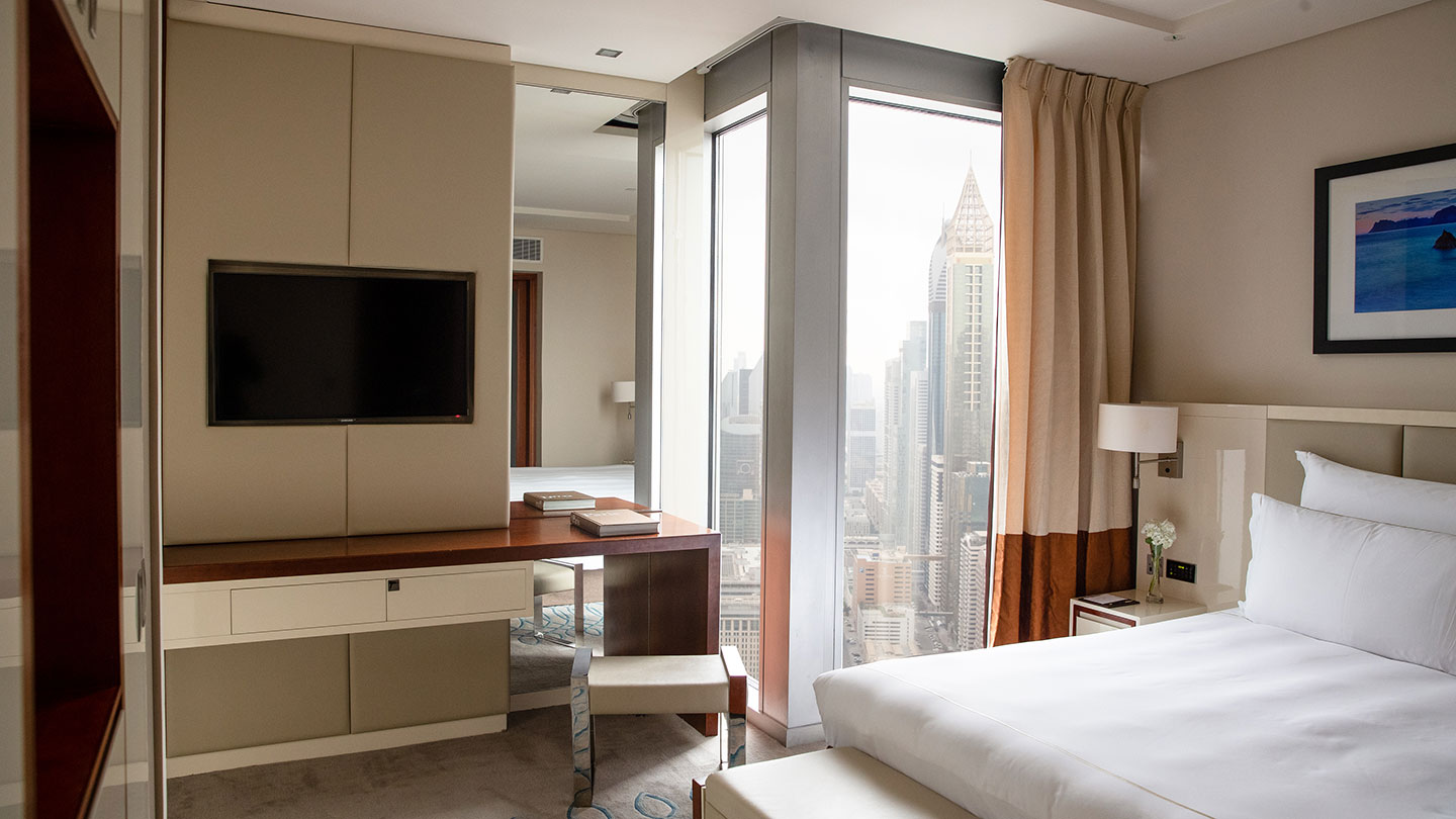 Jumeirah Emirates Towers bedroom of luxury suite with corner window views