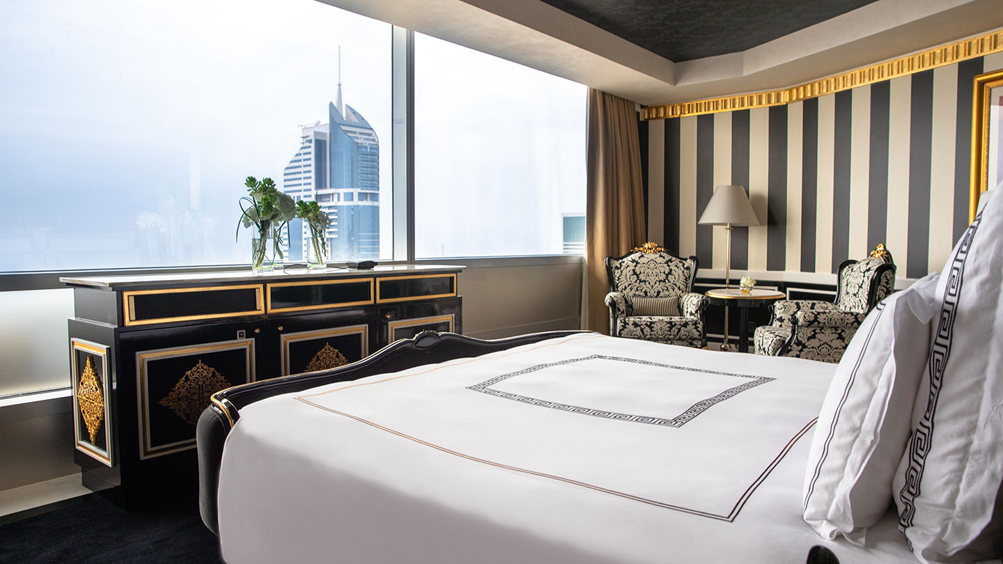 Jumeirah Emirates Towers gold and black versace inspired bedroom with vast views