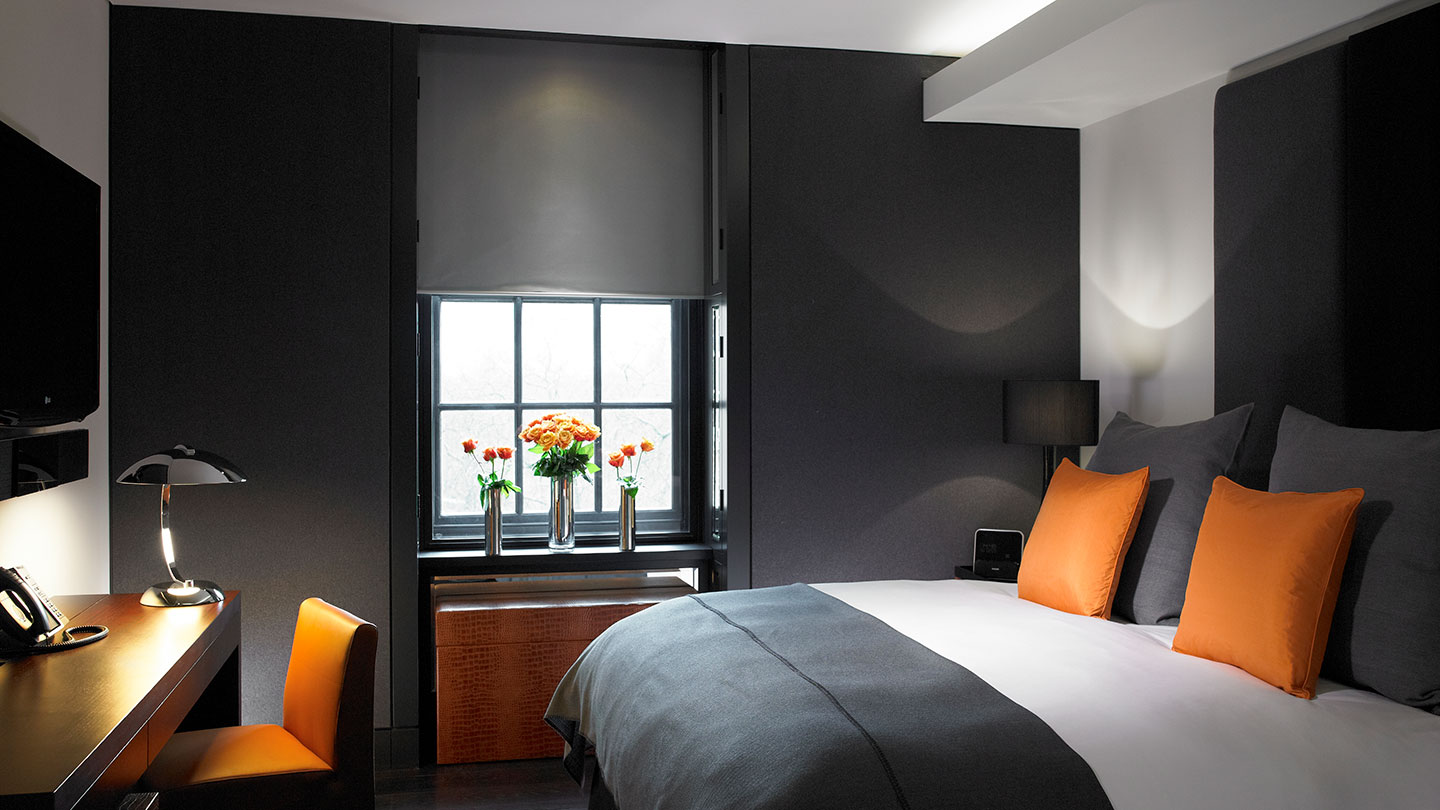 bedroom with orange assets