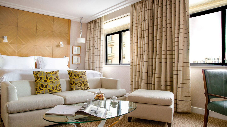 Bedroom with sofa and table at Jumeriah Carlton Tower