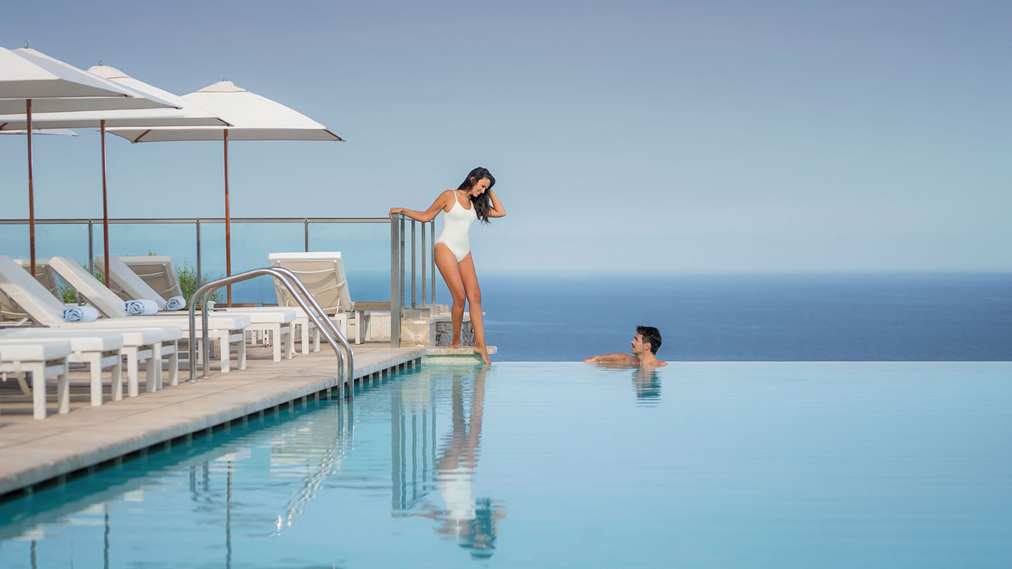 Couple in Infinity Pool at Jumeriah Port Soller Hotel & Spa
